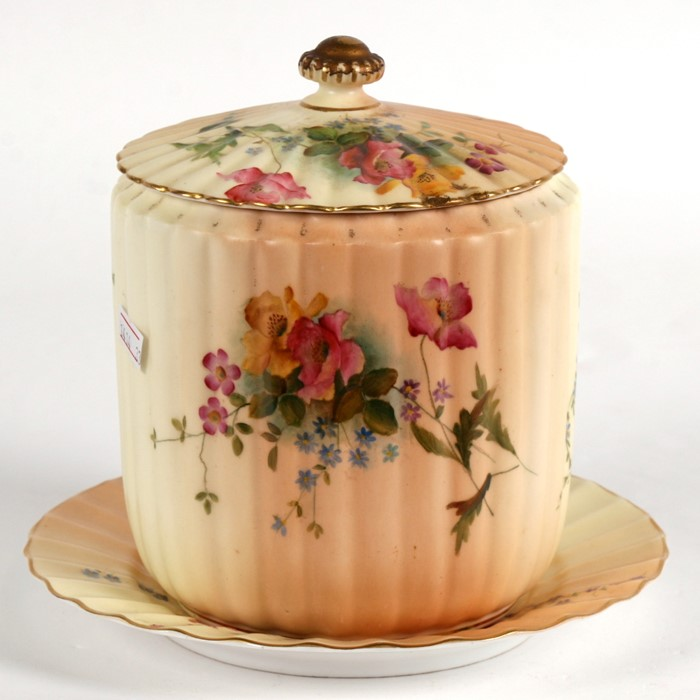 Lot 69 - A Victorian Royal Worcester biscuit barrel on stand decorated with flowers on a blush ivory