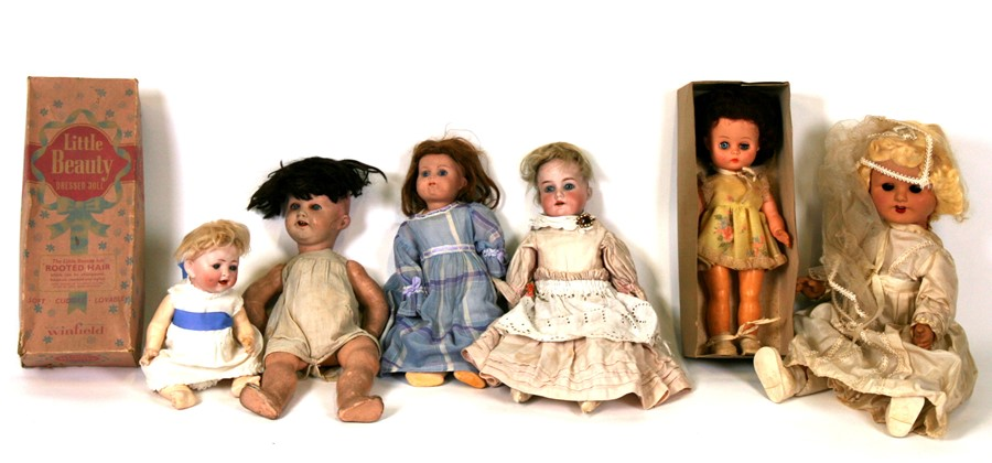 Lot 103 - A group of bisque headed, composite and early plastic dolls.