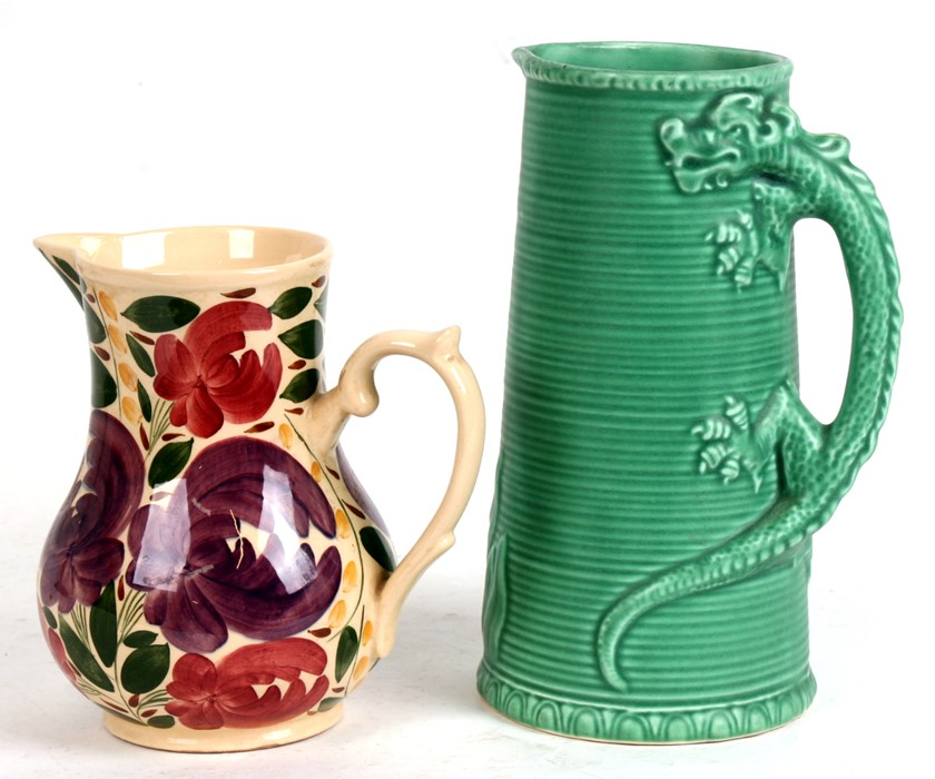 Lot 85 - A Sylvac jug with dragon handle, numbered 116, 22cms (8.75ins) high; together with a Wade Harvest