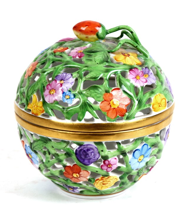 Lot 97 - A Herend pierced porcelain potpourri box and cover decorated with flowers, 10cms (4ins) high.