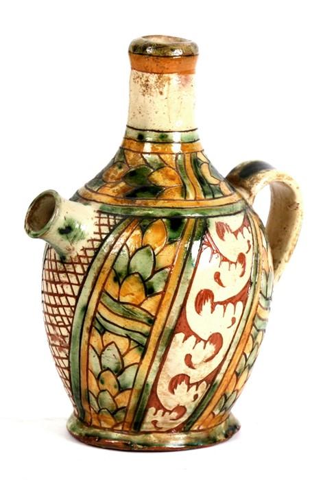 Lot 95 - An Italian maiolica wine ewer, 20cms (8ins) high.
