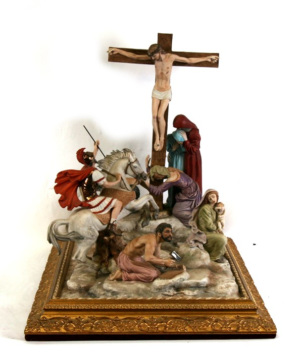 Lot 90 - A large Capodimonte porcelain figural group depict Christ's Crucifixion, mounted on a gilded