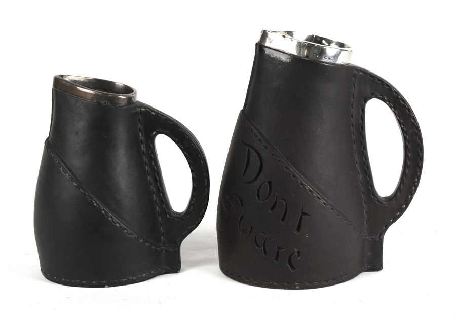 Lot 31 - A Victorian Doulton Silicon silver mounted leather jack jug, London 1891, 20cms (8ins) high;