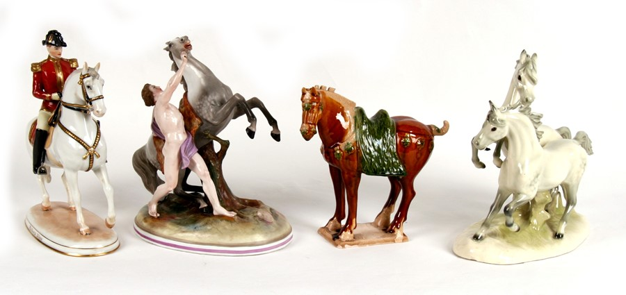 Lot 76 - Three continental porcelain horse groups; together with a Chinese Tang style horse, the largest