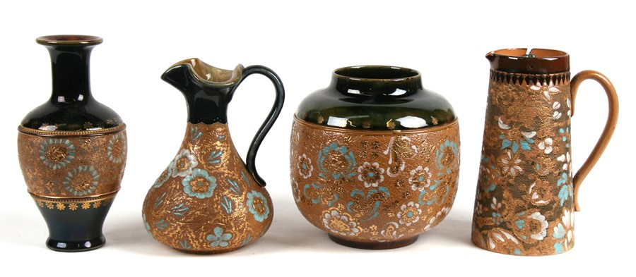 Lot 38 - A group of Royal Doulton Stoneware items to include two vases, a water jug and a ewer, the largest