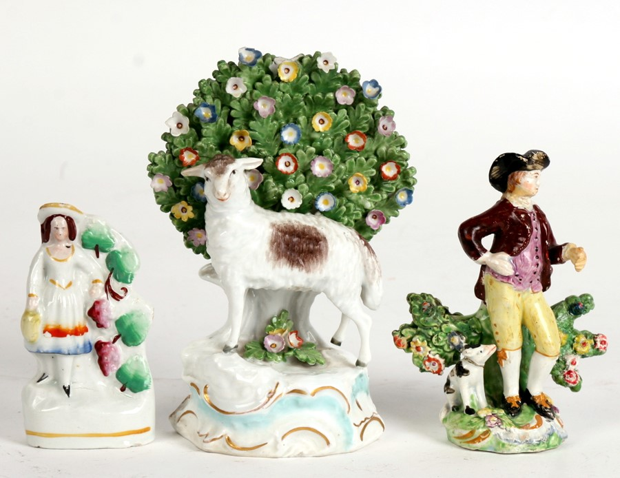Lot 83 - A small Staffordshire pottery figure; together with two Derby style figures, the largest 16cms (6.