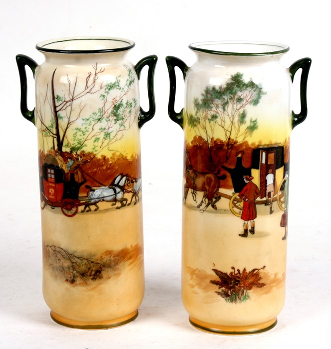 Lot 66 - A pair of Royal Doulton Series Ware vases decorated with a coaching scene, 22cms (8.5ins) high.