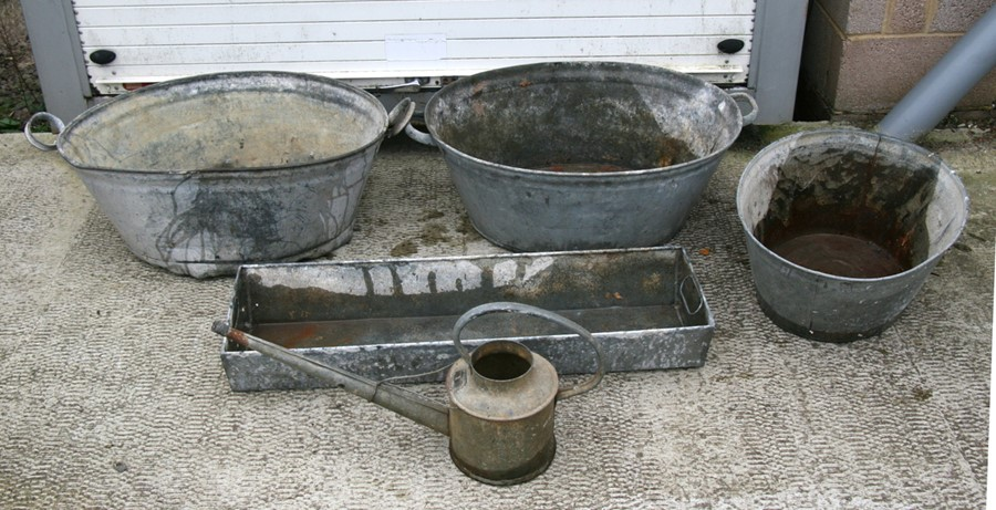 Lot 6 - Three graduated galvanised tin baths, the largest 85cms (33.5ins) wide; together with a galvanised