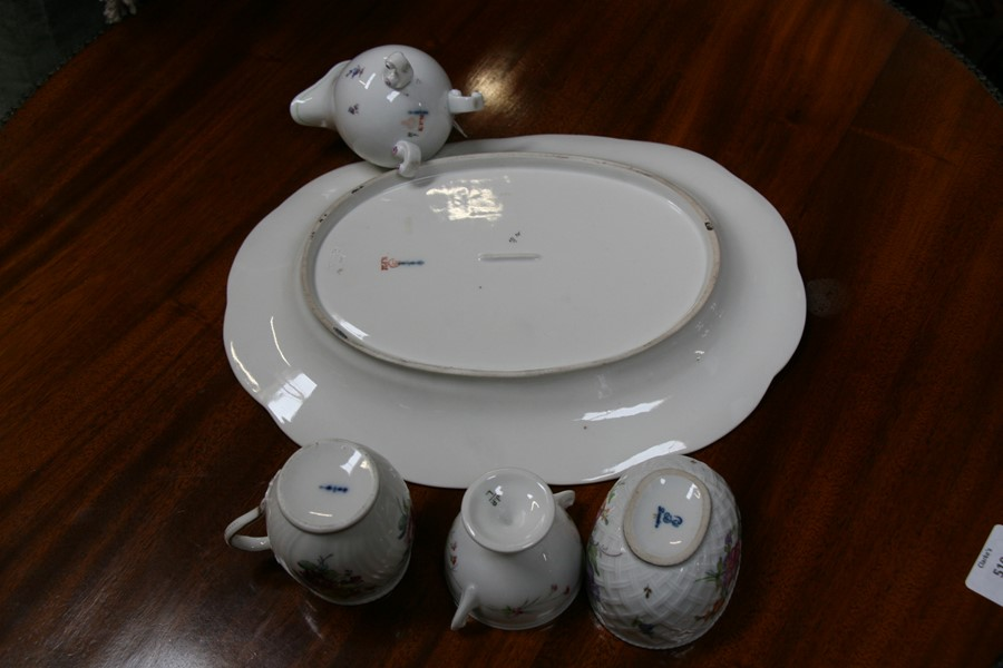 Lot 99 - A KPM oval dish; together with a KPM jug and KPM pot and cover; a Dresden pot and cover and other