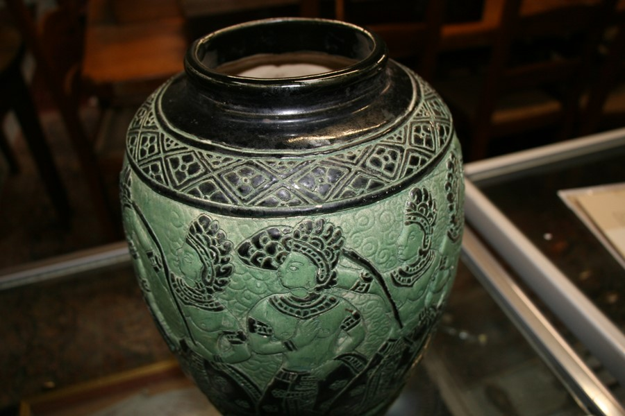 Lot 94 - A Bombay school style vase decorated with figures on a green ground, 34cms (13.5ins) high.