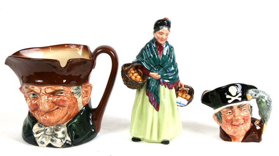 Lot 64 - A Royal Doulton figure - The Orange Lady, 20cms (8ins) high; together with two Royal Doulton