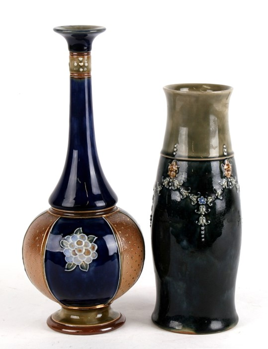 Lot 23 - A Royal Doulton Stoneware vase decorated with flower swags, 23cms (9ins) high; together with a