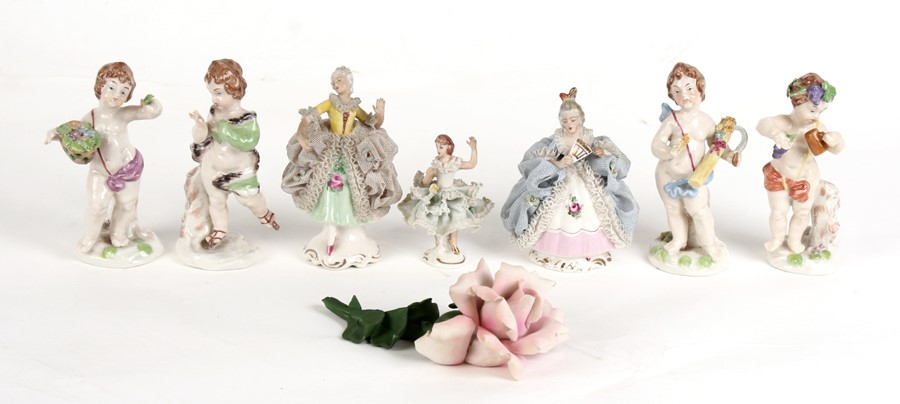 Lot 82 - A group of Naples and Dresden figures, the largest 12cms (4.75ins) high.