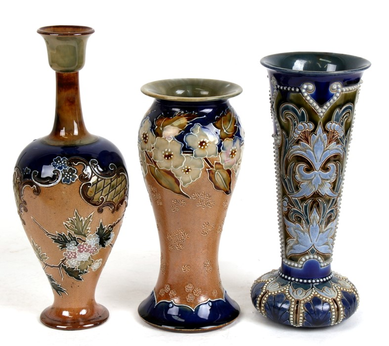 Lot 54 - Three Royal Doulton stoneware vases, the largest 28cms (11ins) high (3).Condition Reportall pieces