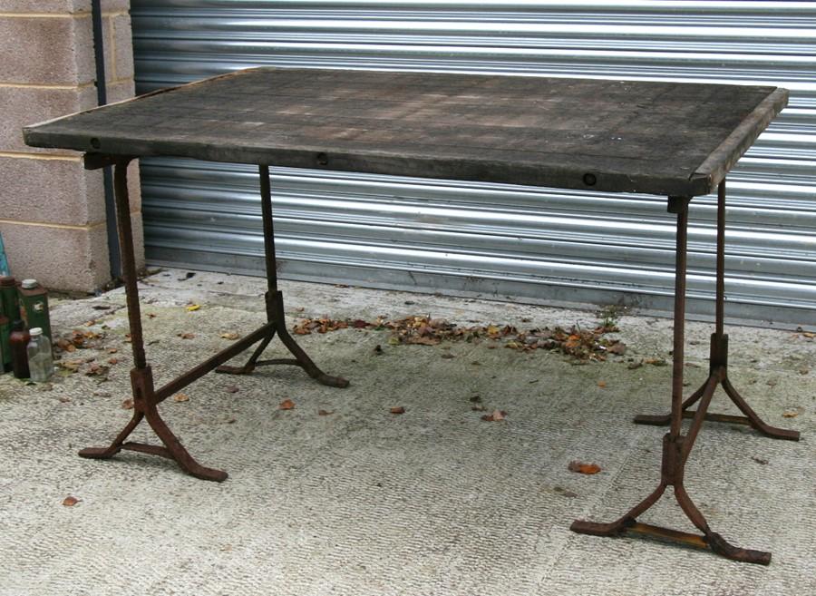 Lot 7 - An industrial style heart oak garden table, 141cms (55.5ins) wide.