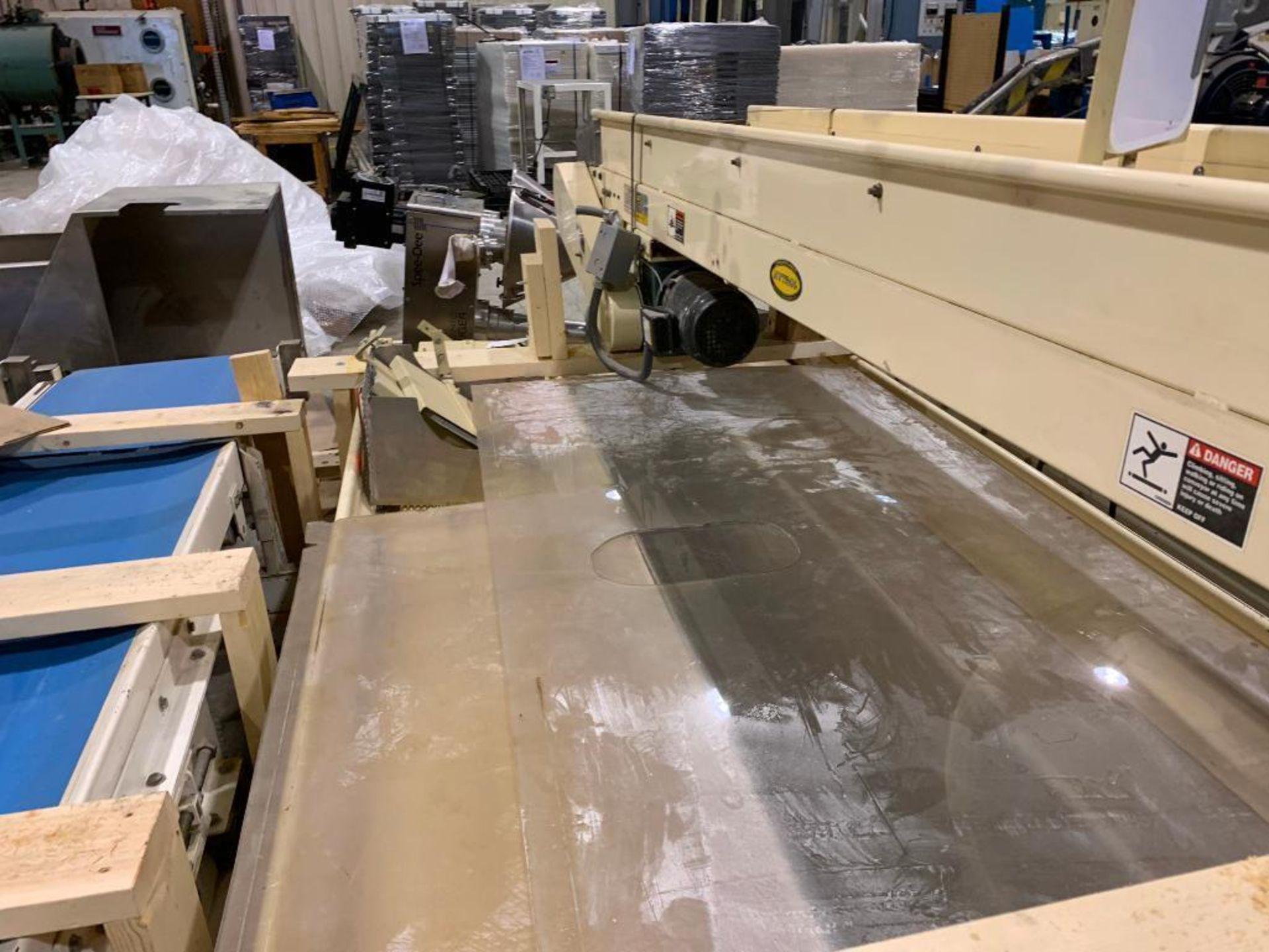 Lot 153 - Mild steel conveyor frame on skid. (Located in Kenosha, WI)
