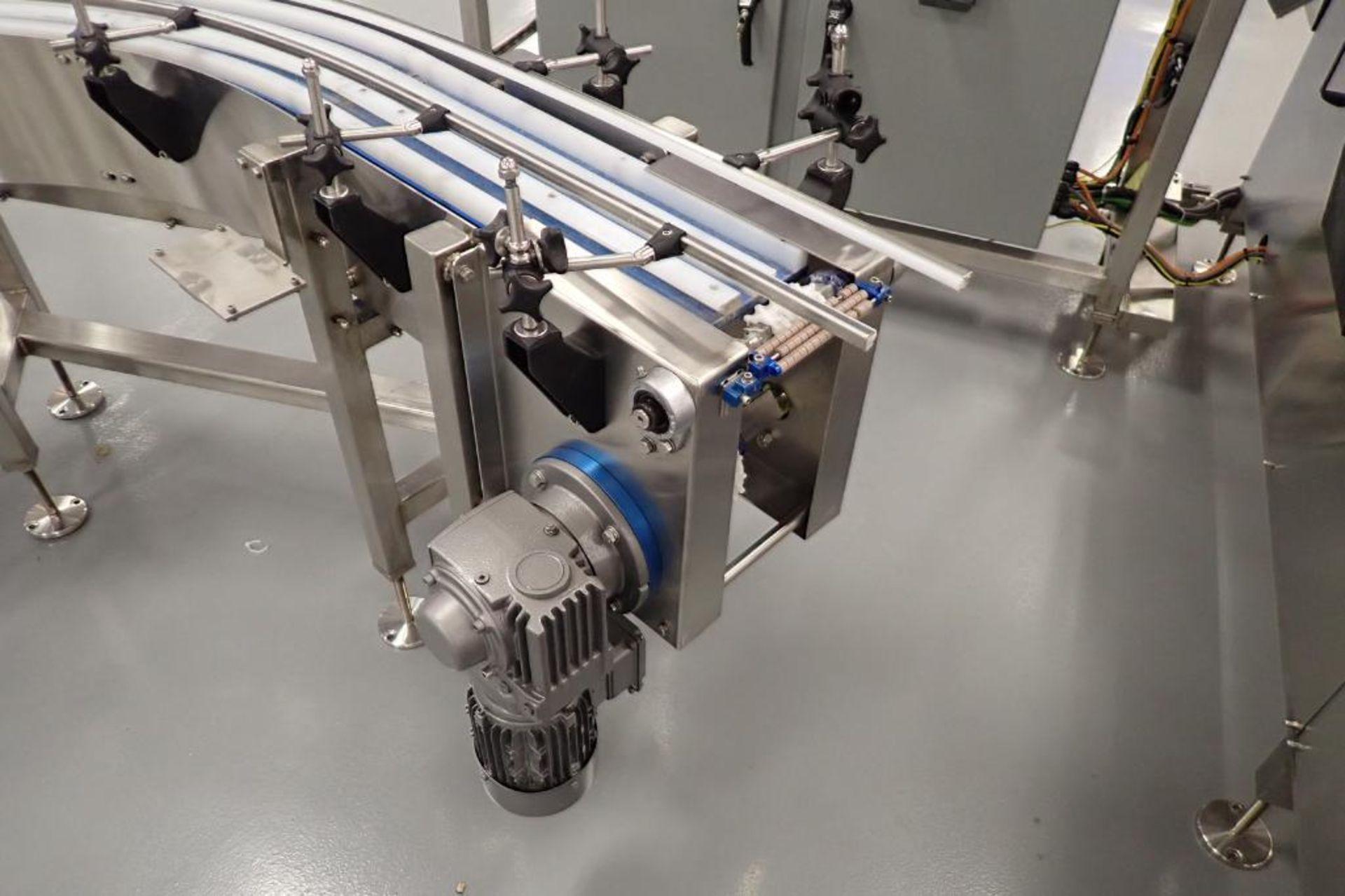 Lot 7 - FEMC 90 degree S turn conveyor, approximately 10 in .wide, overall 120 in. long x 94 in. wide, motor