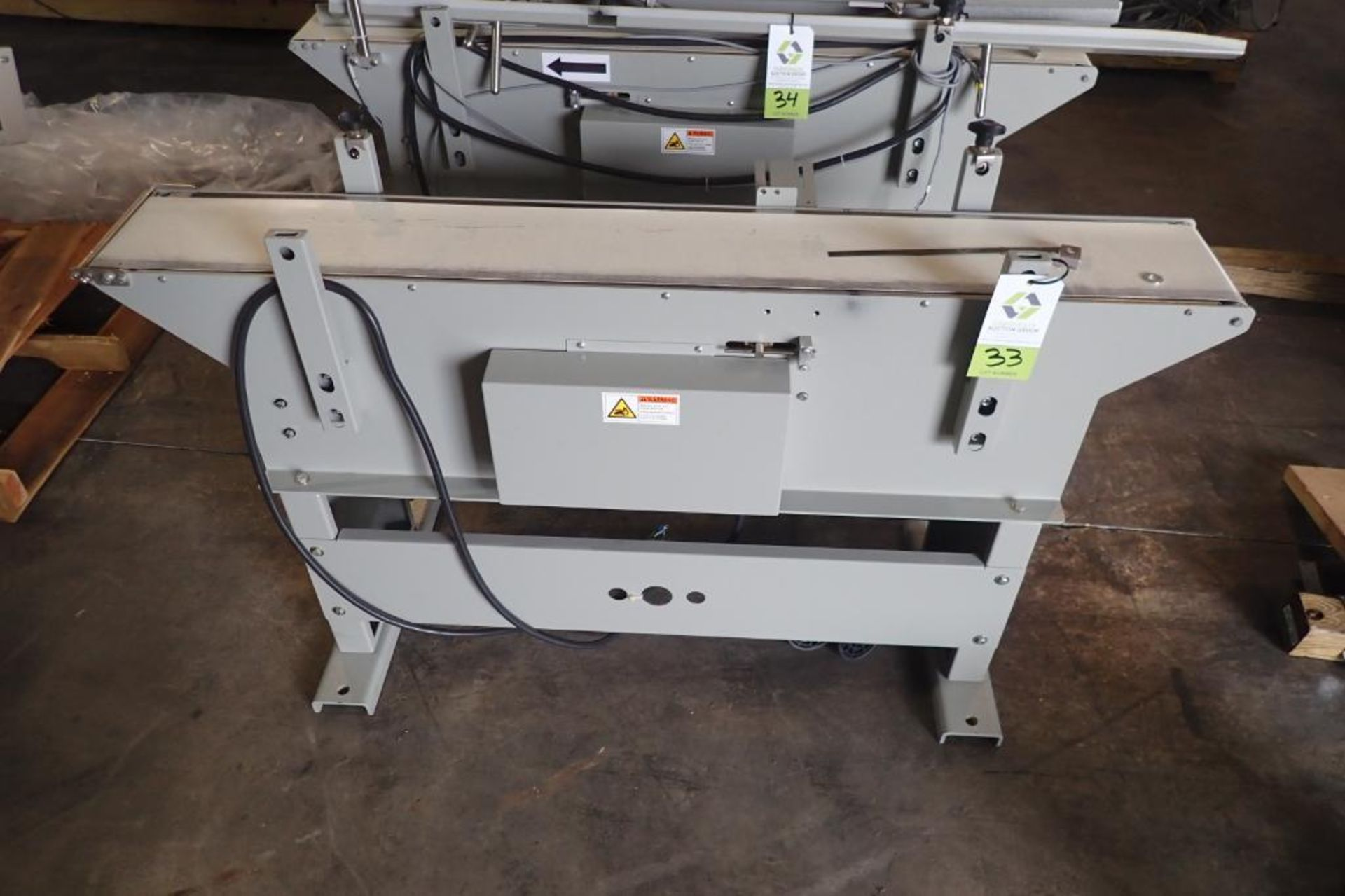 Lot 33 - Stork Texwrap transfer conveyor, Model STE-SA438, SN SA0213, white vinyl belt, 60 in. long x 7.5 in.