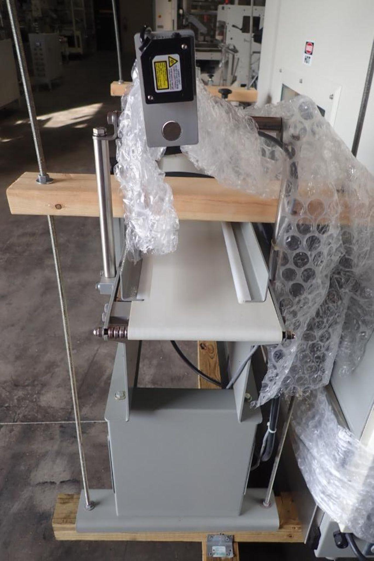 Lot 36 - Stork Texwrap transfer conveyor, Model STE-SA438, SN SA0214 , white vinyl belt, 60 in. long x 7.5