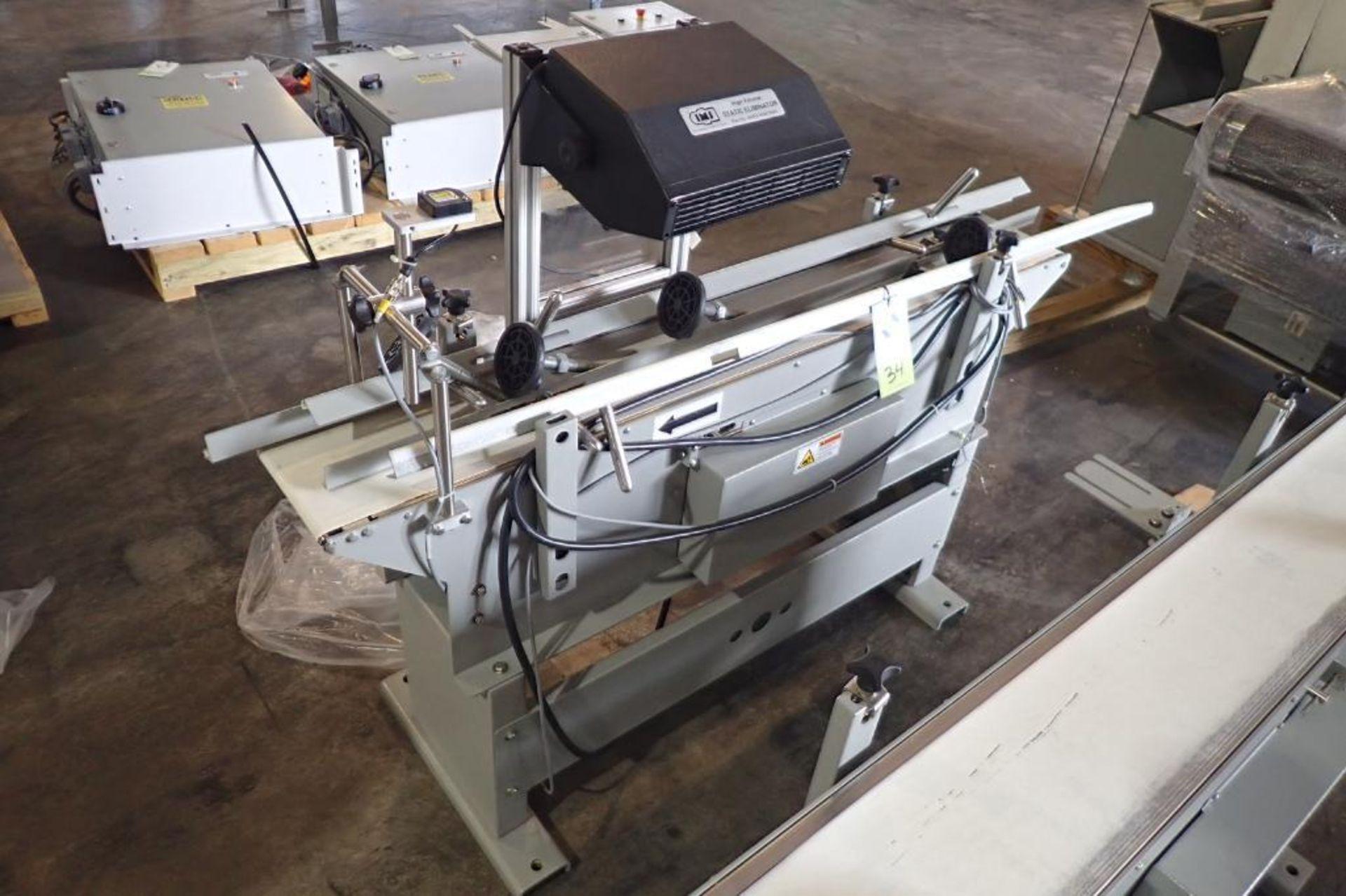 Lot 34 - Stork Texwrap transfer conveyor, Model , high volume static eliminator, white vinyl belt, 60 in.