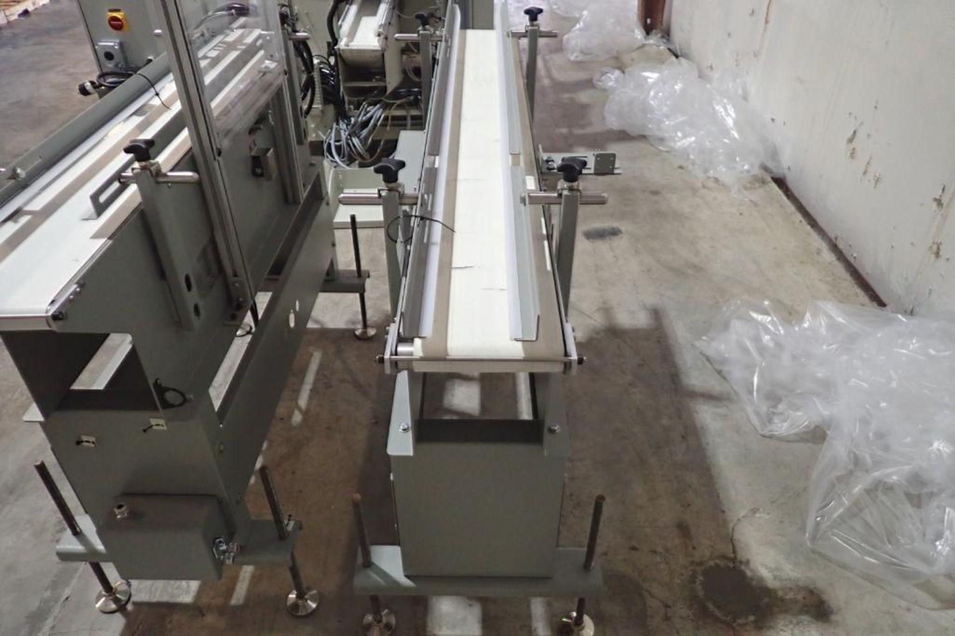Lot 32 - Stork Texwrap transfer conveyor, Model STE-SA438, SN SA0215, white vinyl belt, 60 in. long x 7.5 in.