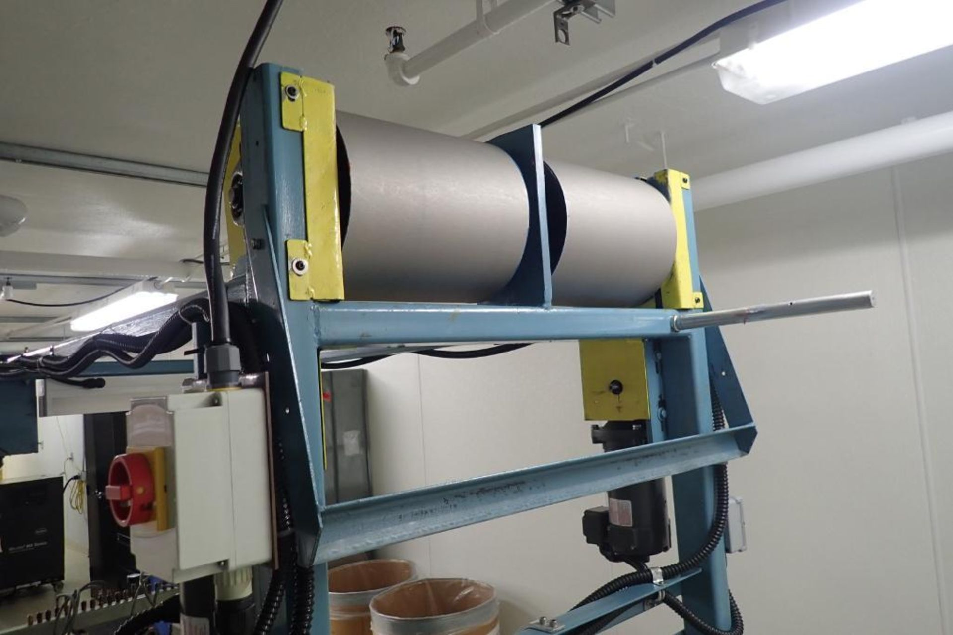 Lot 13 - Custom slitter, (2) 14 in. wide rolls, up to 14 slits, AC tech smart drive { Rigging Fee: $200}