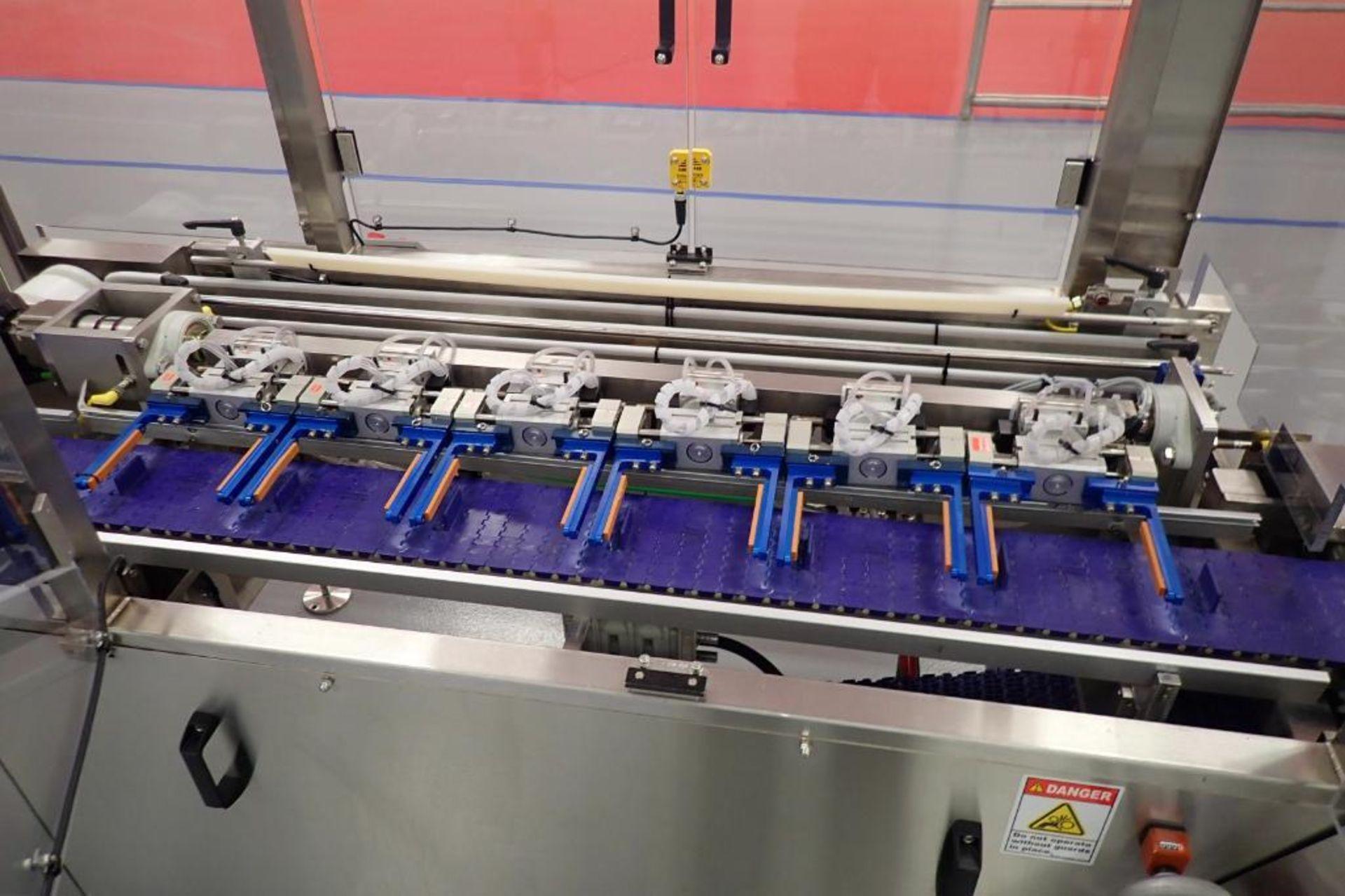 Lot 4 - 2015 FEMC conveyor system, Model 8100-124, SN 8666 vertical conveyor 13 ft. long x 24 in. tall