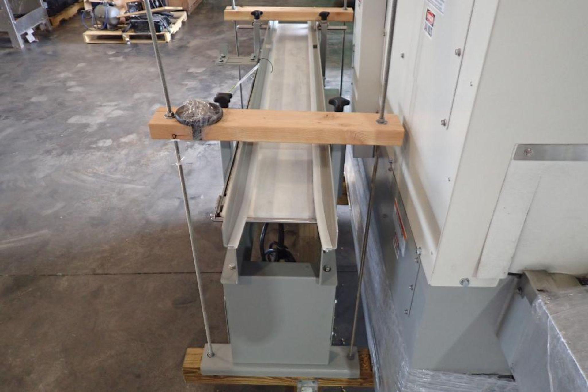 Lot 37 - Stork Texwrap transfer conveyor, Model STE-SA359, SN SA0218 , white vinyl belt, 60 in. long x 7.5