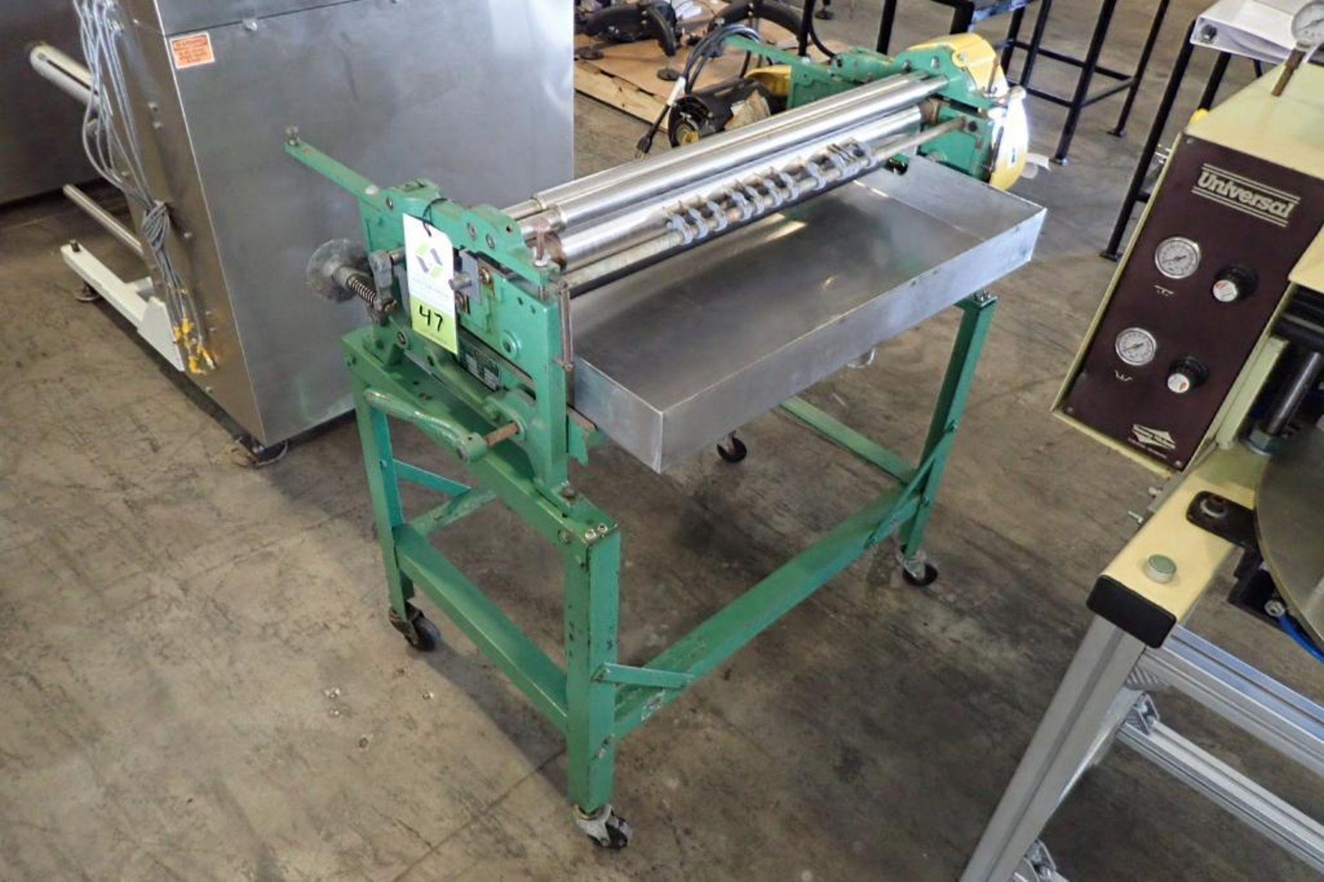 Lot 47 - Potdevin film roll feeder/stiller, Model NTZ27-86, SN 2-106, 27 in. wide, 115 volt, mild steel