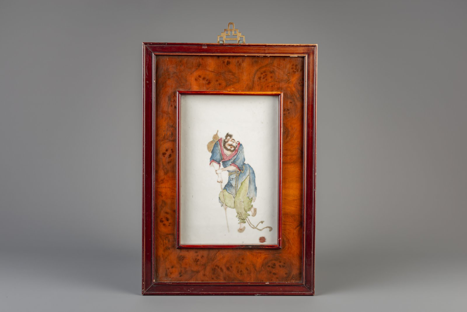 Lot 38 - A framed Chinese famille rose plaque with Li Tieguai, 19th/20th C.