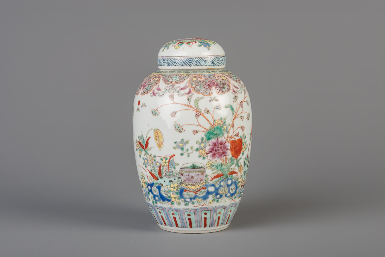 Lot 48 - A Chinese famille rose ginger jar and cover with floral design, 19th C.