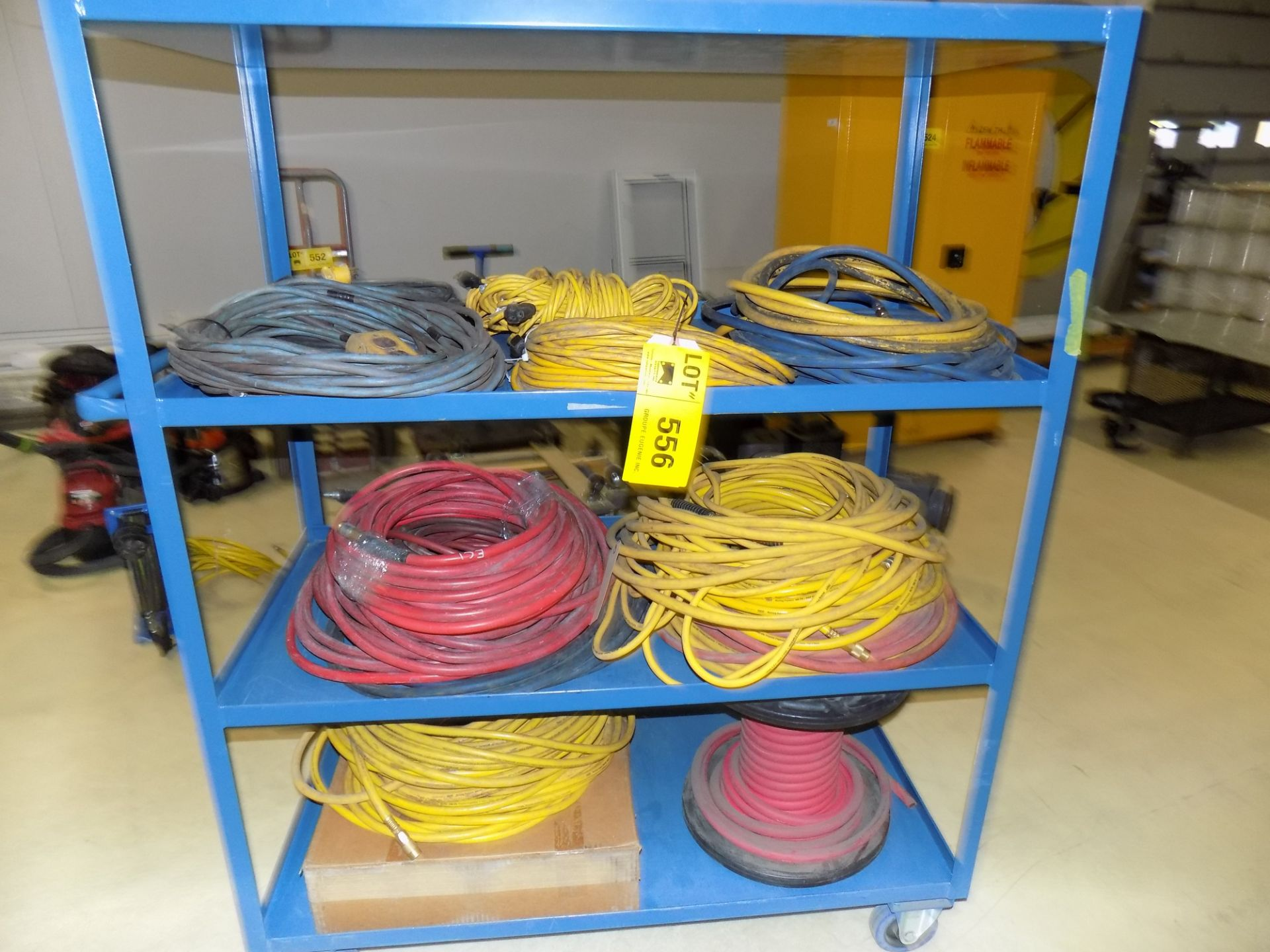Lot 556 - LOT/ EXTENSION CORDS AND AIR HOSE WITH REELS AND CART