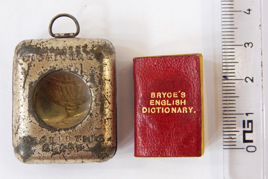 Lot 59 - Bryce's English Dictionaryincl. The Smallest Dictionary in the World, metal case with window