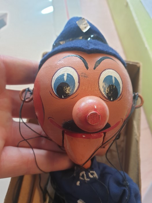 Lot 639 - Boxed Pelham puppet PC 49Condition ReportThe black tape on the side of the policeman's head are