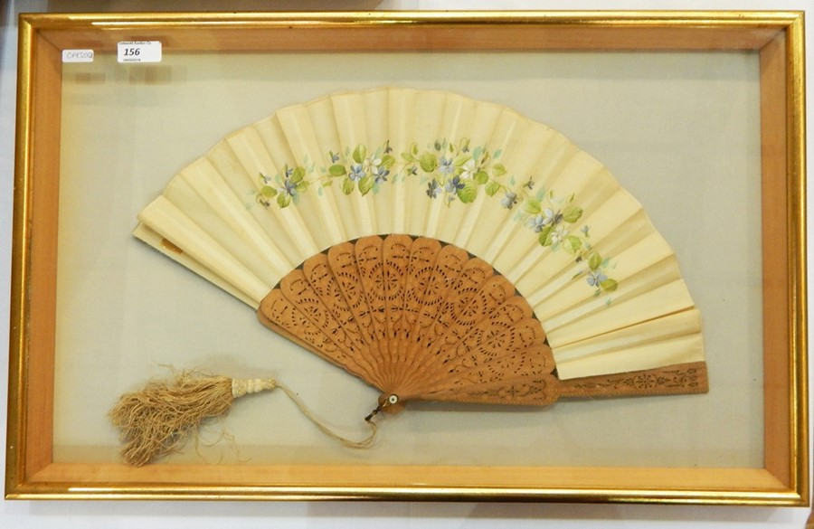 Lot 68 - Painted silk and stamped wood fan, framed, pierced and stamped, with a silk tassel, depicting