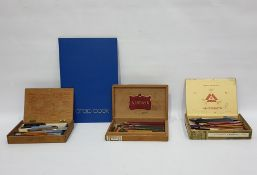 Box of artist's materialsto include brushes, paper, a guillotine,two black painted tin boxes,