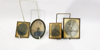 Three 19th century gilt metal photograph frames enclosing photographic portraits and an oval metal