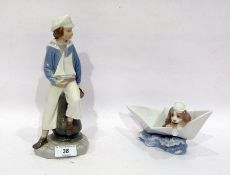 Two Lladro figures, printed blue marks, comprising: a lady sailor modelled seated holding a