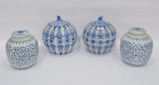 Two pairs of modern Chinese porcelain blue and white vases, comprising: an oviform fluted pair