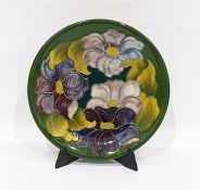 Moorcroft pottery 'Hibiscus' pattern green ground plate, impressed Moorcroft, made in England and