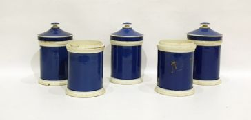 Five Staffordshire pottery blue ground storage jars and three covers, variously inscribed in gilt