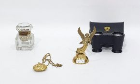 A pair of Negretti & Zambra field glasses, cased, a gilt-metal pendant formed as a purse, a figure