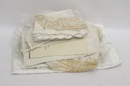 A quantity of linen, to include embroidered place mats, napkins and table cloths and crocheted place