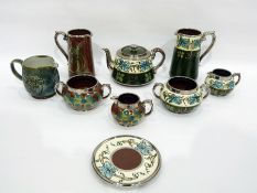 Gibsons lustreware part tea service, printed black marks, painted with bands of blue flowers and