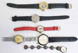 Quantity old wrist watches together with a pedometer