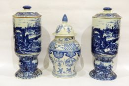 Pair of modern porcelain Chinese-style blue and white cylindrical sectional vases and covers,