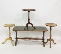 Three reproduction wine tablesand a coffee tablewith leatherette inset top, on lyre supports