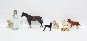 Beswick model of a horse, 25cm long, a model of a spaniel, two various models of dogs, a pair of