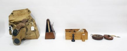 Gas maskby Siebe, Gorman & Co Ltd, a quantity of Players cigarette cards, a metronome, a part chess