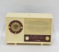 Ekco radio, model number A244, within an ivory-coloured plastic case with claret ground panels, 31cm